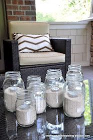 Add sand and a tea light candles to mason jars for super cute lighting for the summer. The best part? Smaller candles = less brightness = fewer bugs!