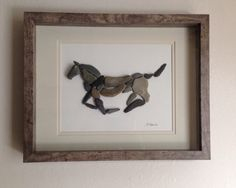 Pebble art of a running horse, double matted 8x10 opening and displayed in a wood 11-7/8 x 14-7/8 x 1-3/4 shadowbox. Beautiful art for the