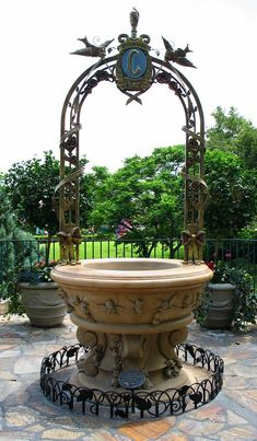 wishing well for the garden area- this one is Cinderella's wishing well at Disneyland. Museums would be less cutesy and more mystical.