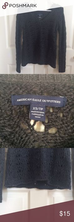 NWOT American Eagle Sweater Adorable American Eagle open knit sweater. Size XS but would fit a S too. No tears or stains. Only been worn twice and in perfect condition. Dark grey with a v neck. MAKE ME AN OFFER 😊 American Eagle Outfitters Sweaters V-Necks