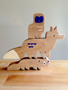 Great Grey Owl, Coyote, and Fisher. Part of a wooden toy set based around the animals of Yosemite, by Alexander Vidal.