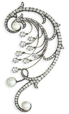 AN ANTIQUE RUSSIAN PEARL AND DIAMOND BROOCH. The large scrolling spray set with old-cut diamonds and a rose-cut diamond fringe to the pearl terminals, mounted in silver and gold, late nineteenth century, 12.6 cm long, with St. Petersburg assay mark (pre 1896)