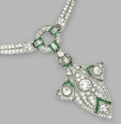 Detail: Tiffany and Co diamond and emerald necklace.