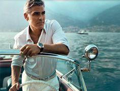 george clooney, on a boat in italy...dashing.