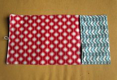 Might need to try this one...  Sisters, Sisters: Baby Changing Mat/ Diaper Clutch Tutorial