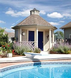 Backyard pool and changing room. I'm planning lots of outdoor parties and a pool adds to the fun.