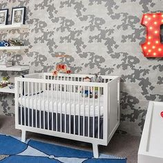 Boy Nursery with Camouflage Wallpaper