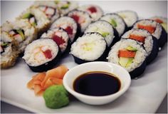 Food: In this picture we see a plate of sushi. This is a very popular dish in Japan. In Sushi you usually find fish, vegetables, and rice with a seaweed layer around it. The fish could be served raw or cooked. It is called bare ai in Japanese.