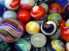 A two gallon glass apothecary jar of these makes a colorful  & joyful statement. Vintage marbles.