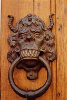 Tooth, horned monster door knocker Quelque part en France posted on Flickr - Photo Sharing! by Marie-France durieux