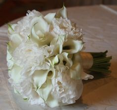 Can we do this for the bridal bouquet and also add ivory roses?  is it possible to make the color as uniform ivory as possible?  Ivory peonies, ivory calla lilies and ivory roses?