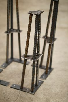 "Industrial Table Leg- 16"" Height- 1/2 ReBar  16"" height works well for coffee tables, benches, end tables, etc.  Table legs are constructed using ½"" rebar and various sizes of steel plate. All components are hand cut and shaped using various metalworking techniques. These components are then laid out in custom-made jigs and welded together to form the finished legs.   Legs are priced as:  - Un-finished: In this state the legs can be painted or left as bare steel (keep in mind that bare s..."