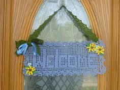 Ravelry: Spring Welcome Sign pattern by Julia Schwartz ~ I love this use of filet crochet!  I can't wait to make one for my front entry!  The Pattern is FREE too!  Thanks Julia!