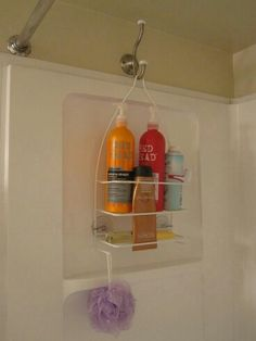 Use a coat hook above shower surrounded to hang shower caddy!
