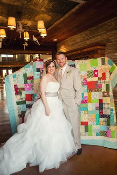 We asked our guests to send back a piece of fabric with their RSVP to help make a wedding quilt. It turned out amazing! Quilt: www.makingquilts4u.com Photo: Carter Rose www.f8studio.com