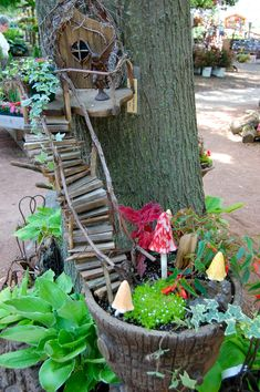 A planter, with wooden stairs, that lead to a fairy's door -- That's cute.