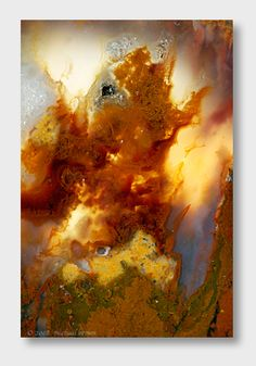 This is actually a slice from a flame agate (rock).  It looks like an abstract painting don't you think?