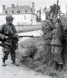 German soldier surrendering to a U.S Paratrooper, Normandy, 1944. http://wrhstol.com/2ueGjg0