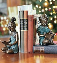 "Solid Brass ""Reading Children"" Bookends w/ Lost-Wax Casting - Crafted for use as sturdy book ends or sculptural pieces. Lost-wax casting provides exquisite detail. Artfully finished w/ verdigris patina & gleaming polish. Gift these to someone for displaying their favorite books & youthful nostalgic memories.  $119.95"