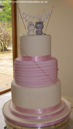 3 Tier wedding cake with pleated detail and hand moulded cute cats cake topper