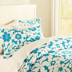Blue and white comforter with flowers