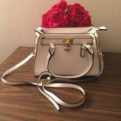 Charming Charlie's white mini handbag Charming Charlie's mini white handbag with long adjustable & removable shoulder strap. Charming Charlie Bags Shoulder Bags