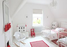 Shared room for two girls. Lovely, fresh white and pink colour schemes with iron beds.