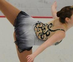 Sk8 Gr8 Designs.Custom Figure Skating Dresses - Black Scrolls adorn the back of a silver grey dip dyed figure skating dress. www.sk8gr8designs.com