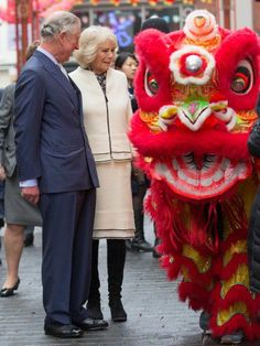 Charles and Camilla really admired the work of the dragons.
