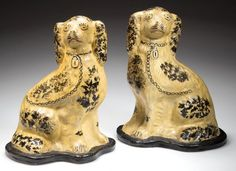"Sold $14,000  RARE AND IMPORTANT PAIR OF STAMPED ""JOHN BELL"", WAYNESBORO, PENNSYLVANIA PAINTED EARTHENWARE / REDWARE SPANIEL FIGURES, facing left and right, each hollow seated figure molded after corresponding English Staffordshire spaniels of the same period. Original paint over a white-slip wash, black-painted shaped bases with impressed mark to underside of each. Left facing example bears an early label inscribed ""Mrs. James A. ??? / Quincy, Pa. / PO Box 20 / (before 1888)"" on interio"