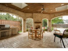 Lovely outdoor living area with kitchen, fireplace, skylights, w