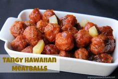 Tangy Hawaiian Meatballs, slow cooker style for ease can be ate alone as an appetizer, or serve on a bed of rice as an entree. Recipe at My Organized Chaos
