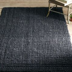 5'8' Rug.  Boucle knot rug in faded black. Natural Jute Fiber.  Perfect alone or layered underneath accent rug.