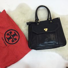 Tory Burch leather purse Smooth leather purse with double handle. Interior is divided by a pocket. Has a cute gold lock as an accent Tory Burch Bags