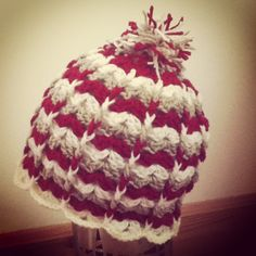 Scalloped hat for toddler with pompom