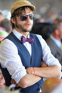 Ashton Kutcher went uber prepster at The Kentucky Derby in a bow tie, vest & trendy shades with a keyhole bridge