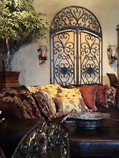 If you are having difficulty making a decision about a home decorating theme, tuscan style is a great home decorating idea. Many homeowners are attracted to the tuscan style because it combines sub… Wine Bottle Display, Wrought Iron Wall Decor, Old Screen Doors, Tuscany Decor, World Decor, Tuscan House, Mediterranean Home Decor, Tuscan Decorating, Tuscan Style