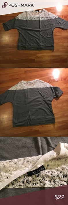 Sweatshirt w lace detail Relaxed fit, sits at hip. Gray sweatshirt w cute lace detail at top-dress up your basics! Perfect condition.  Open to offers! a.n.a Tops Sweatshirts & Hoodies