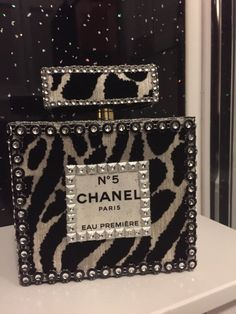 This beautiful chanel inspired room decor would grace anyones dressing table . made from glue,paper,cardboard. measures 5 tall 5half  wide 2 depth please include your name and number. If you dont see the colour you are looking for convoy me ,Im always happy to help