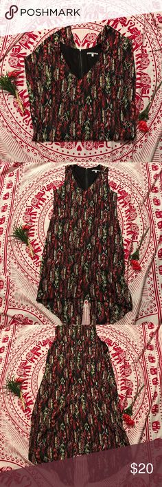 Collective Concepts High-Low Slit Back Dress Adorable and lightweight dress from Collective Concepts. Modern with a feather multi-color pattern design and a v-slit in its high-low back. Open to offers! Collective Concepts Dresses High Low