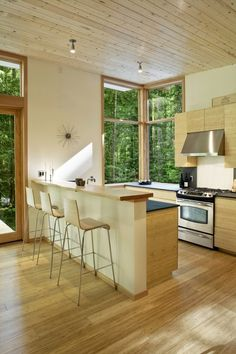 cabin kitchen with corner windows