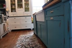 teal island w/butcher block top, white open cabs painted yellow inside w/black countertops...yep.