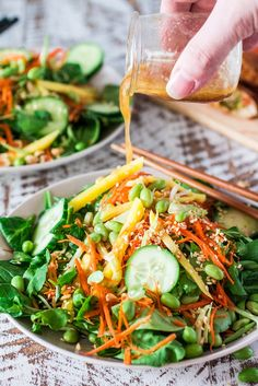 Asian Salad with Sesame Ginger Vinaigrette   www.oliviascuisine.com   Spinach and watercress tossed with carrots, crunchy broccoli stems, mango, cucumbers, edamame, crushed peanuts, sesame seeds and a delicious sesame ginger vinaigrette. Serve with Pagoda egg rolls to make it a meal! #FrozenFromScratch #ad
