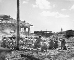 OCT 10 1944 Peleliu – the Marines are still mopping up snipers - See more at: http://ww2today.com LET 'EM HAVE IT – Crouched behind a coral wall, Marines of the First Division fire on Japanese snipers barricaded in this building on Peleliu Island in the Palau group.