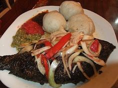 Food Ghana Style - Banku and tilapia.  Sena makes Banku for me all the time; usually with some kind of stew.