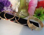 Vintage Lot of Four Gold Plated Enameled Crystal Jeweled Bangle Bracelets. Three are single bangles and one curves around your arm. A great investment wear them with anything. Best, C. CCCsVintageJewelry.com