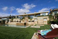 Newport Beach yard on Newport Bay. www.DetailsADesig... #detailsadesignfirm #swimmingpool #pool #beachhouse #beachdecor #coastalliving #interiordesign #interiordesigner #remodel