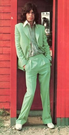 This is Mick Jagger in a lighter teal colored suit. He is solo in this picture, without the rest of his stones.