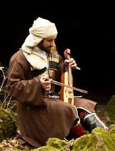 Circassian musician in traditional costume.  Clothing style: early 20th century.