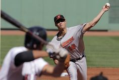 Baltimore Orioles starting pitcher Wei-Yin Chen delivers to the Boston Red Sox during the first inning of a baseball game at Fenway Park in Boston, Wednesday, Sept. 10, 2014. (AP Photo/Charles Krupa)